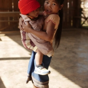 Hill tribe girl with child, Laos